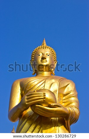 Stand Golden Buddha Statue in Thailand. Buddha was donated to the shared villagers. - stock photo