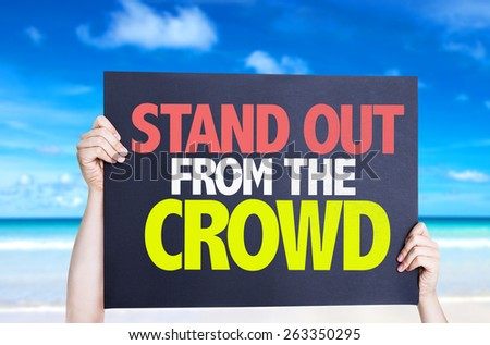 Stand Out From the Crowd card with beach background - stock photo