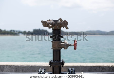 Stand pipe fire hydrant at boat pier for emergency - stock photo