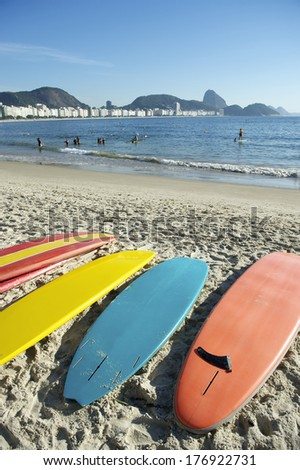 Stand up paddle long board surfboards on Copacabana Beach Rio de Janeiro Brazil - stock photo