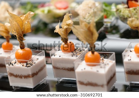 Stand-up snack with cape gooseberry indoor catering - stock photo