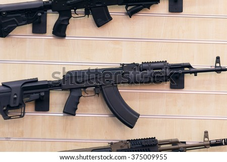 Stand with automatic rifle. Weapon and self-defense  - stock photo