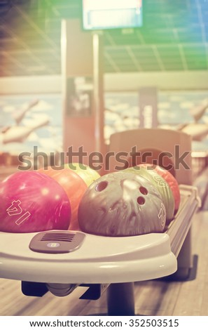 Stand with balls for bowling - stock photo