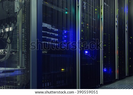 Stand with server hardware and lighting in the server room - stock photo
