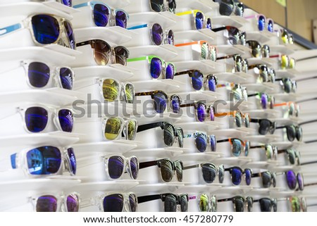 Stand with sunglasses Sunglasses on sale at the city market - stock photo