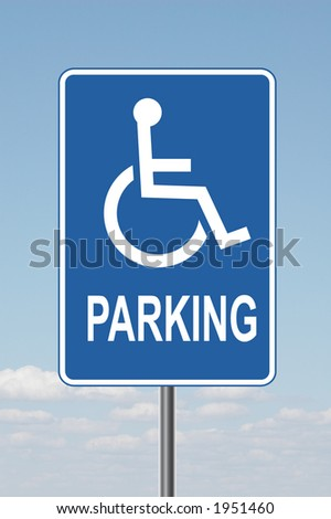 Standard disabled sign with clouds in the background - stock photo