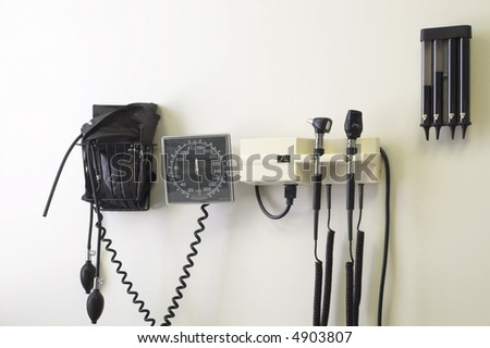 Standard doctor's office equipment mounted to a wall. - stock photo