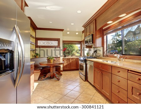 Standard kitchen with nice wide counters and wood cabinets.