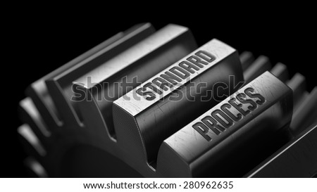 Standard Process on the Metal Gears on Black Background.  - stock photo