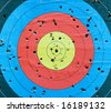 Standard targets are marked with 10 evenly spaced concentric rings, which generally have score values from 1 through 10. - stock photo