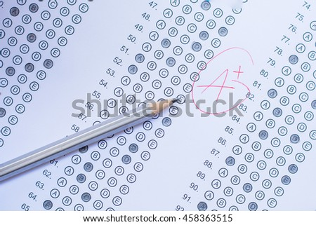 Standardized test form with answers bubbled in and a pencil