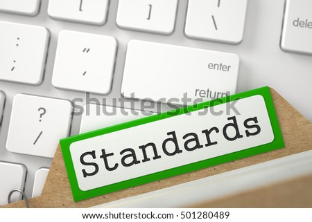 Standards. Green File Card on Background of Modern Metallic Keyboard. Business Concept. Closeup View. Blurred Image. 3D Rendering.
