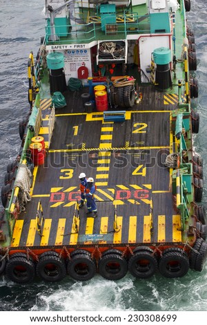Standby/resque boat transporting people to nearby rigs - stock photo