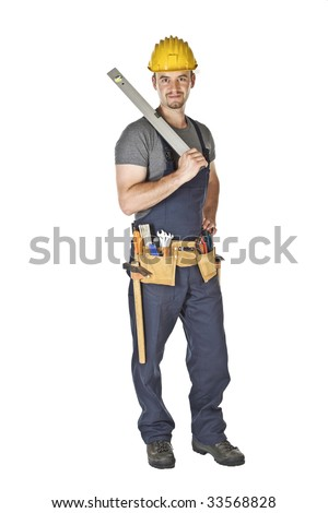 standind handyman holding spirit level isolated on white