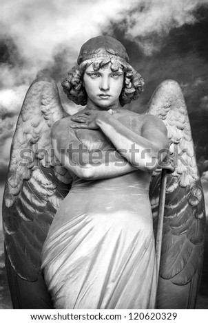 standing and staring angel - stock photo
