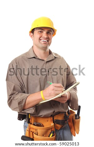 Standing architect builder writing out work details - stock photo
