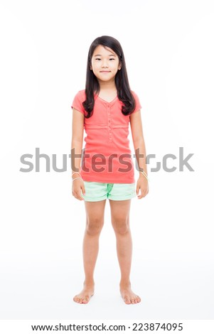 Standing  Asian girl isolated on white.  - stock photo