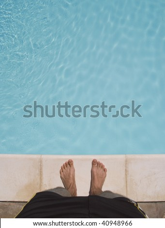 standing at the edge of a swimming pool. about to jump in. great for copy-text. - stock photo