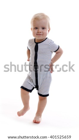 Standing baby boy looks forward. Isolated on white background - stock photo