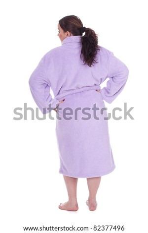 standing back black hair overweight, woman in bathrobe - stock photo