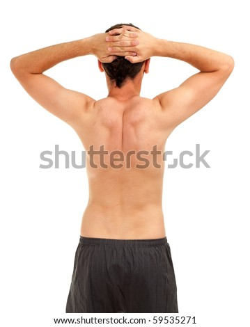 standing back naked man with hands on head - stock photo