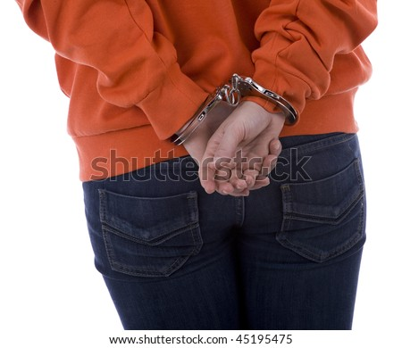 standing backwards woman from hands for backs in handcuffs