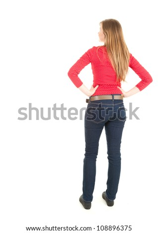 standing backwards young woman, full length, white background