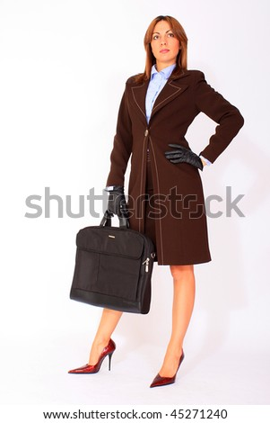 Standing beautiful businesswoman with briefcase
