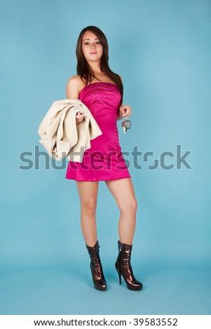 Standing beautiful girl wih fur coat and car key - stock photo