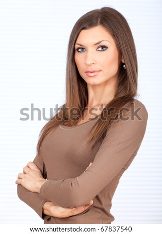 standing beautiful woman with crossed arms - stock photo