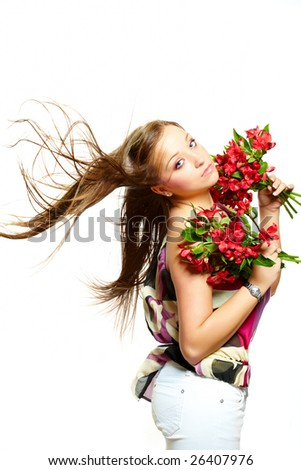 Standing beautiful  young woman with flowers, isolated on white