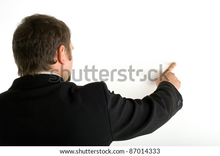Standing behind a man shows his index finger on a white background - stock photo