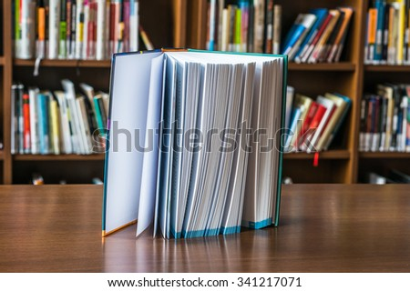 Standing book on the table in library