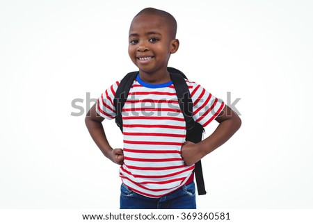 Standing boy with backpack smiling at the camera on white screen