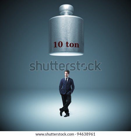 standing business man in bad situation - stock photo