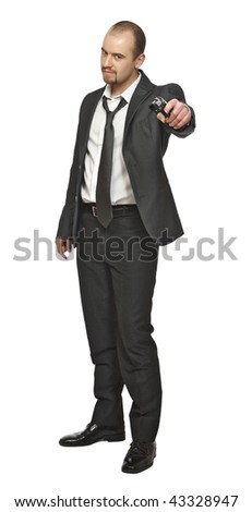 standing business man with gun - stock photo