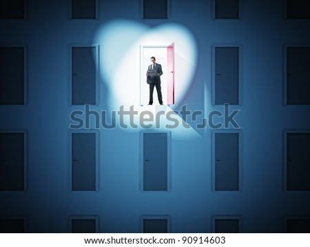 standing businessman and 3d doors - stock photo