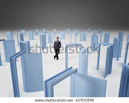 standing businessman and 3d doors background - stock photo