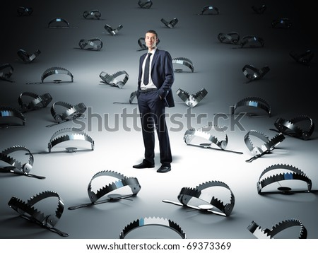 standing businessman and 3d trap background - stock photo
