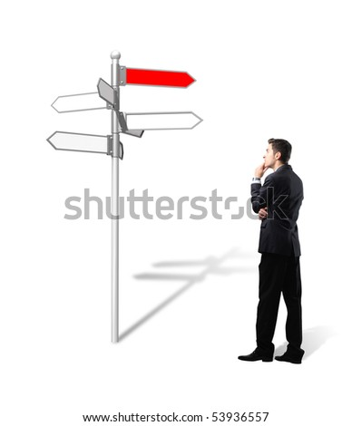 standing businessman think which way is the  best for his business - stock photo
