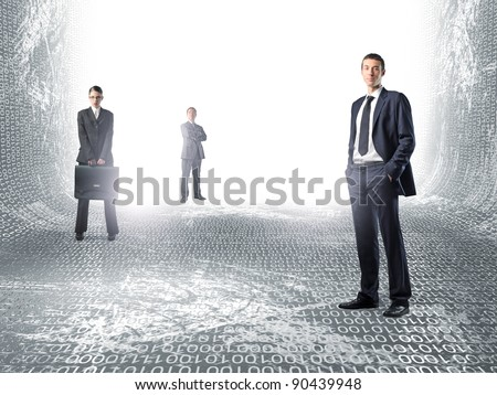 standing businesspeople in virtual world - stock photo