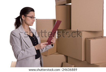 standing businesswoman in glasses with clipboard and carton boxes