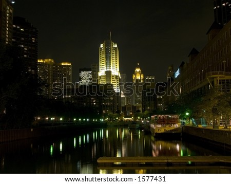 standing by Chicago River at night