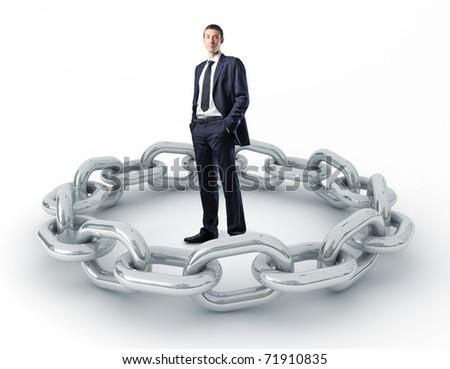 standing caucasian man and metal chain - stock photo