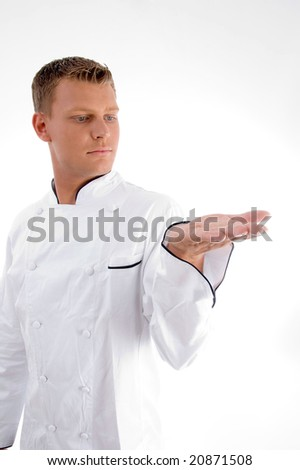 standing chef looking his palm with white background - stock photo