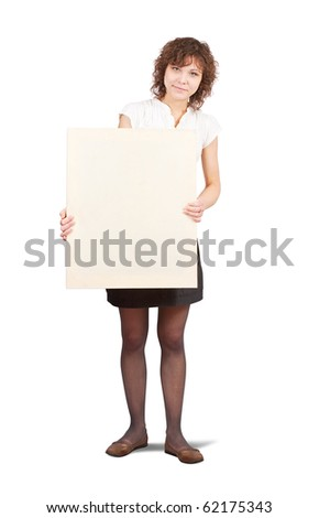 Standing curly girl holds empty poster over white - stock photo