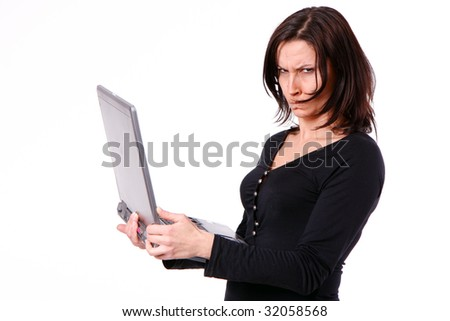 standing, dissatisfied keeping laptop woman - stock photo