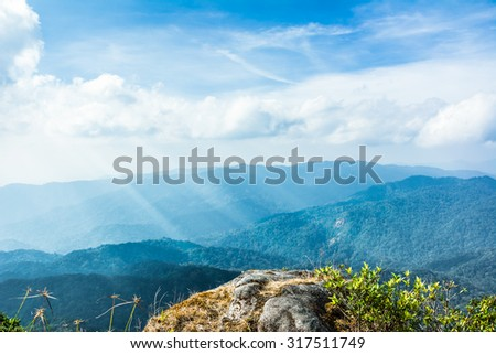 Standing empty on top of a mountain view with sunrays  - stock photo