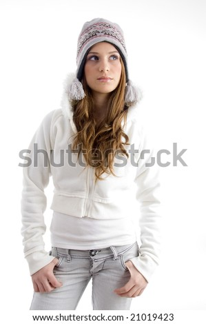 standing female in winter wear against white background - stock photo