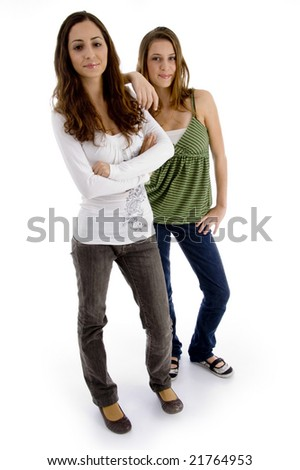standing females with folded hands against white background - stock photo
